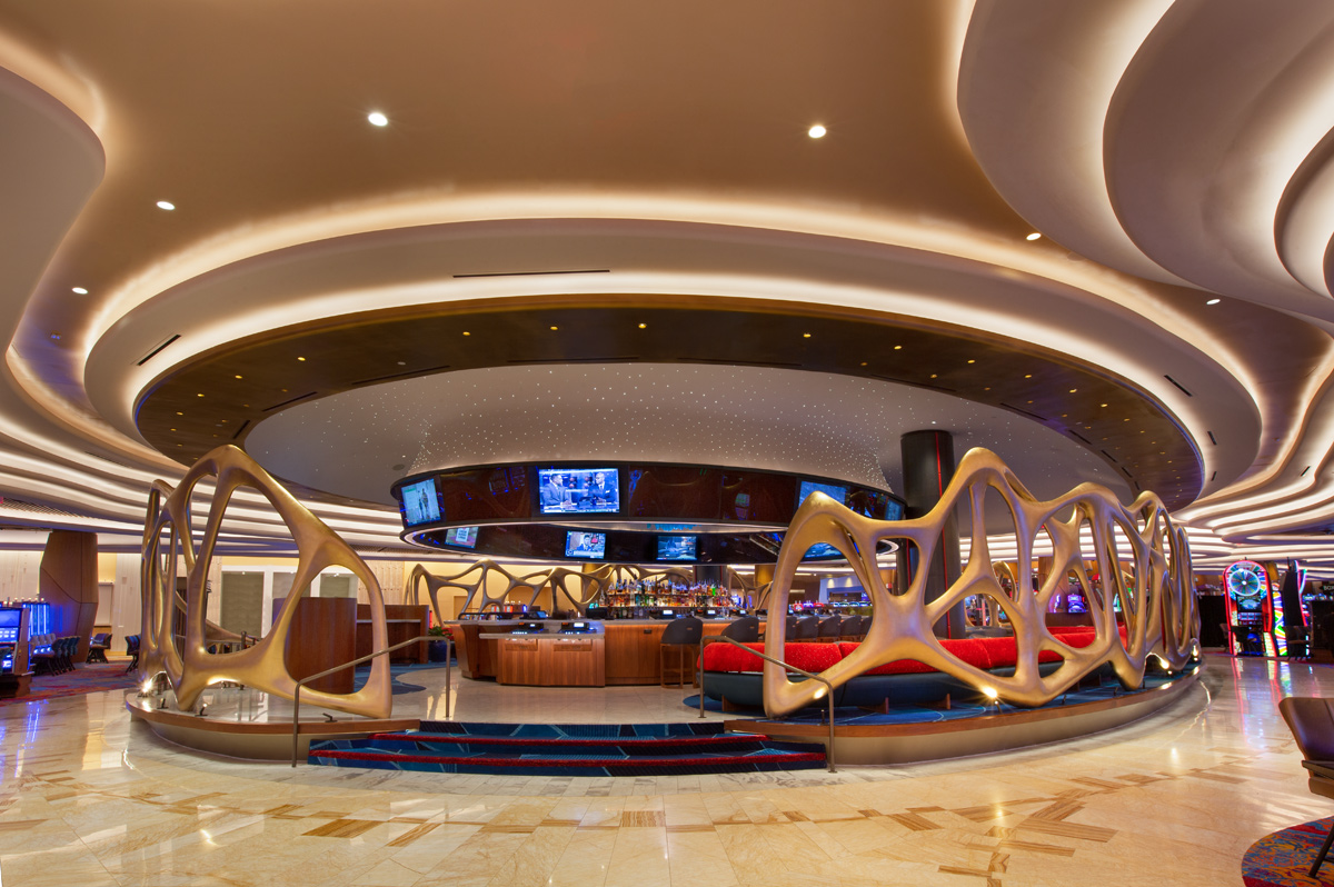 LED linear cove lighting in a casino accenting architectural elements in the ceiling, walls and highlighting architectural elements. Boca Flasher.